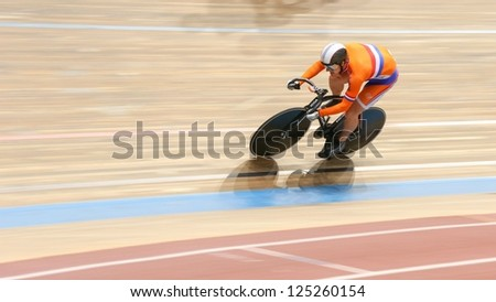 VIENNA,  AUSTRIA - SEPTEMBER 27 - Rigard van Klooster (Nethderlands) competes in the men's team sprint event of an indoor cycling meeting on September 27, 2012 in Vienna, Austria. - stock photo