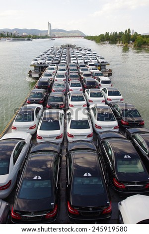 VIENNA, AUSTRIA - SEPTEMBER 15, 2011: Shipping barge full of new cars on September 15, 2011 in Vienna, Austria. Danube River, designated as Corridor 7 is an important nautical transportation route.  - stock photo