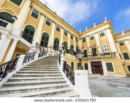 VIENNA, AUSTRIA - SEPTEMBER 11: The front staircase of Schonbrunn Palace on September 11, 2014 in Vienna. Schonbrunn Palace is a former imperial summer residence, designed to glorify Habsburg power. - stock photo