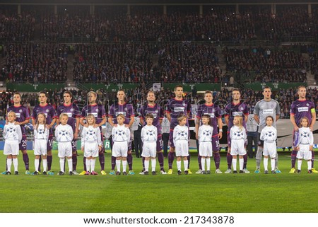 VIENNA, AUSTRIA - SEPTEMBER 18 The team of FK Austria Wien during the national anthem before a UEFA Champions League game on September 18, 2013 in Vienna, Austria. - stock photo