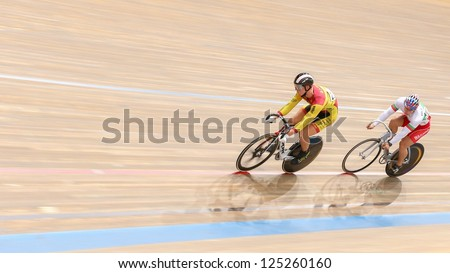VIENNA,  AUSTRIA - SEPTEMBER 28  Tomas Babek (CzechRepublic) and  Miuchev Miroslav (Bulgaria) competes in the men's keirin event of an indoor cycling meeting on September 28, 2012 in Vienna, Austria. - stock photo
