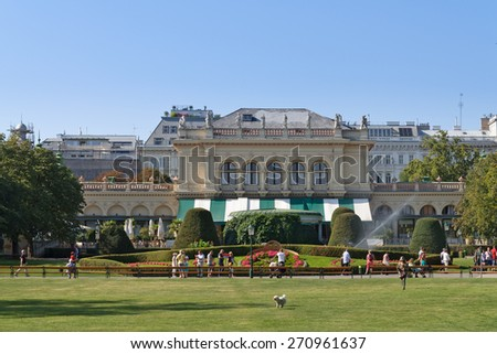 VIENNA, AUSTRIA -  September 6, 2013: Unidentified people enjoy summer in front of the Kursalon, a building in historicist style in Stadtpark (city park), a large municipal park near Ringstrasse.