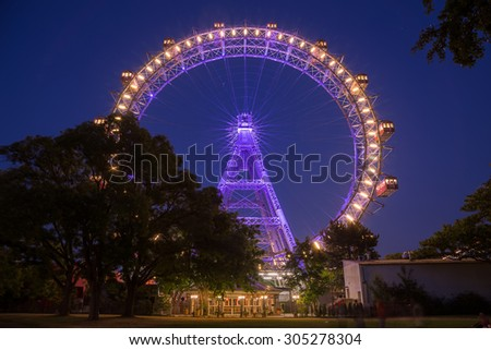 VIENNA, AUSTRIA - 6TH AUGUST 2015: A view of the Wiener Riesenrad in Prater from outside the park at night - stock photo