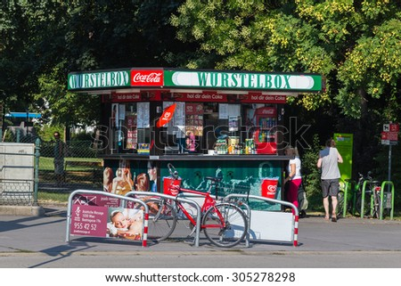 VIENNA, AUSTRIA - 4TH AUGUST 2015: A Wurstelbox food stand in Vienna during the day. People can be seen outside. - stock photo