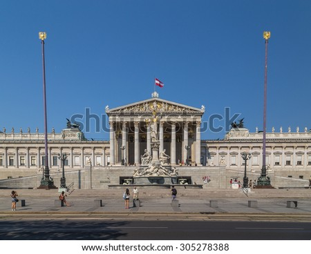 VIENNA, AUSTRIA - 8TH AUGUST 2015: The outside of the Austrian Parliament building during the day. People can be seen outside. - stock photo
