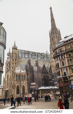 VIENNA, AUSTRIA - 5TH JANUARY 2016: A low view of St. Stephen's Cathedral (Stephansdom) and Stephansplatz in Vienna during the winter. Snow can be seen on the building. People can be seen.
