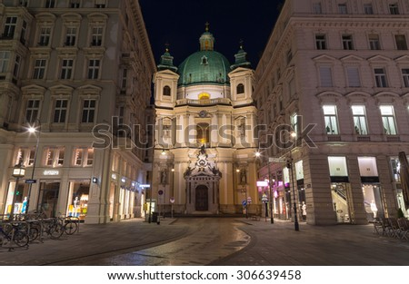 VIENNA, AUSTRIA - 27TH JULY 2015: The outside of the Catholic Church of St. Peter in Vienna at night from the Graben - stock photo