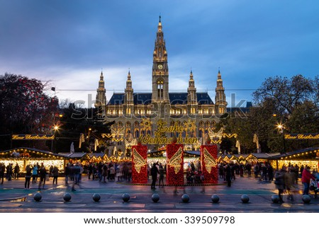 VIENNA, AUSTRIA - 15TH NOVEMBER 2015: The outside of Christmas Market at Rathaus (Vienna City Hall). The blur of people can be seen. - stock photo