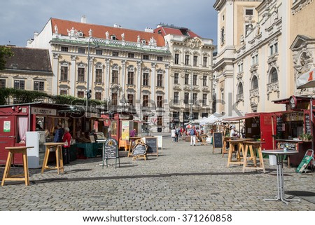 VIENNA, AUSTRIA - 4TH SEPTEMBER 2015: Market Stalls in a cobbled square in the Innere Stadt of Vienna during the day. - stock photo