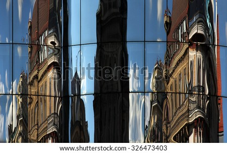 Vienna classic architecture mirrored in the glass of modern building