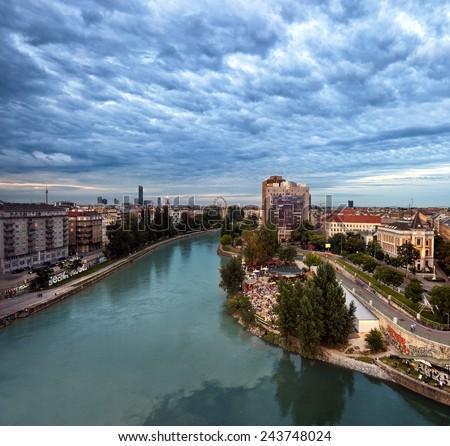 Vienna Danube Canal and the Herrmann beach bar at dusk - stock photo