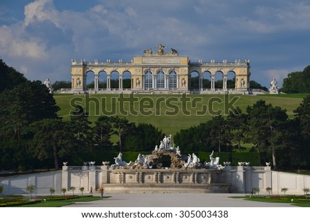VIENNA - JUNE 23: Gloriette at Schonbrunn Palace with gardens on June 23, 2013 in Vienna, Austria. The former imperial summer residence is the most-visited tourist attraction in Vienna. - stock photo