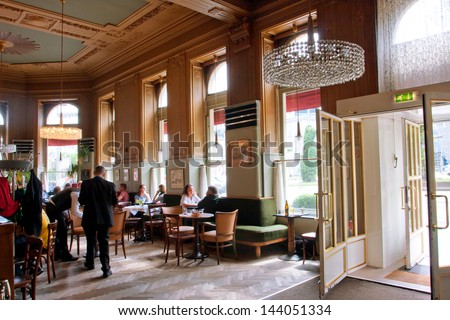 VIENNA - JUNE 5: Interior design and visitors of cafe Westend in typical Viennese style with historical chairs directly to the opposite of Westbahnhof station on June 5, 2013 in Vienna, Austria - stock photo