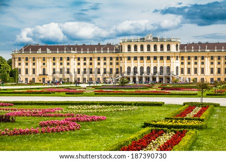 VIENNA - JUNE 14: Schonbrunn Palace with gardens on June 14, 2013 in Vienna, Austria. The former imperial summer residence is a UNESCO World Heritage site and Vienna's most-visited tourist attraction. - stock photo