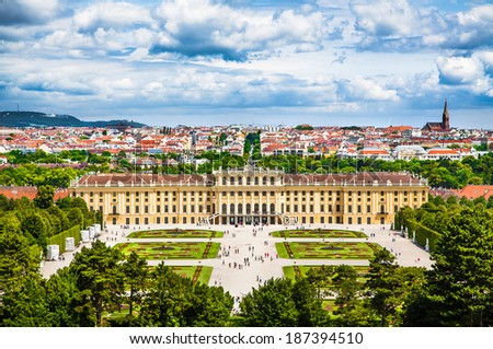 VIENNA - JUNE 14: Schonbrunn Palace with gardens on June 14, 2013 in Vienna, Austria. The former imperial summer residence is a UNESCO World Heritage site and Austria's most-visited tourist attraction - stock photo