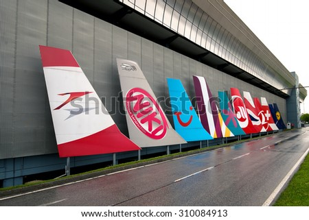 VIENNA - MAY 1, 2015: Different airliners trademarks on airplane vertical stabilizers in front of Vienna airport, on May 1, 2015