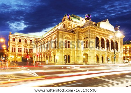 Vienna state opera at night with traffic - stock photo