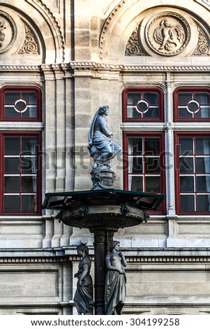 Vienna State Opera (Vienna Court Opera, Wiener Hofoper) is considered one of the most important opera houses in the world. Austria. Beautiful fountain near the Opera. - stock photo