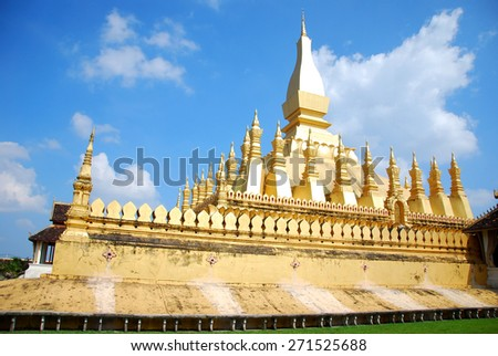 VIENTIANE, LAOS - Wat Thap Luang on blue sky background, That is a gold-covered large Buddhist stupa in the centre  - stock photo