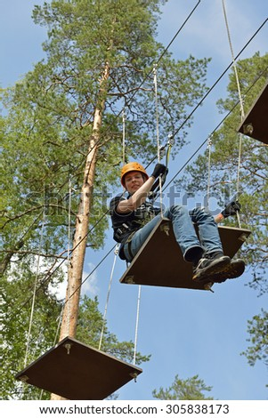 VIERUMAKI,FINLAND - JULY 18,2015:Flowpark is adventure theme park. It is targeted at people older than 6 who have adventurous streak, guaranteed to offer fun challenges to newbies and old hands alike