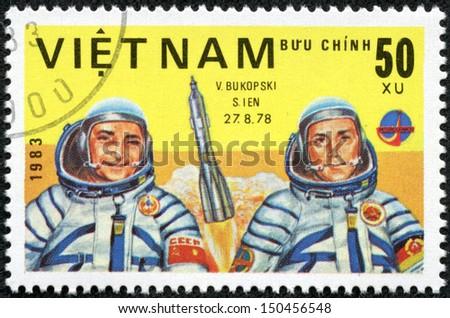 VIET NAM - CIRCA 1983: stamp printed by Viet Nam, shows astronauts Bykovsky, Jahn, circa 1983 - stock photo