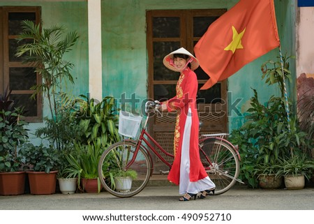 Vietnam,Beautiful woman in Ao Dai vietnam traditional dress