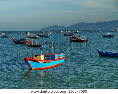 Vietnam boat in sunset - stock photo