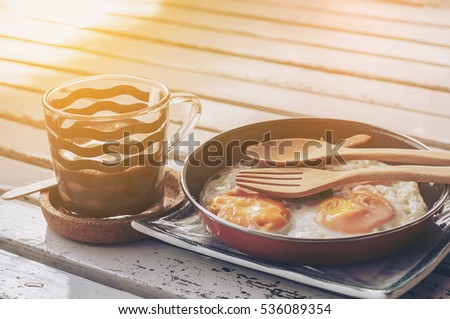 "Vietnam breakfast style, call ""Egg Pan"" but Thai people called ""kai-ka-ta"" and Black coffee,more famous in North-eastern Thailand, copy space for text"