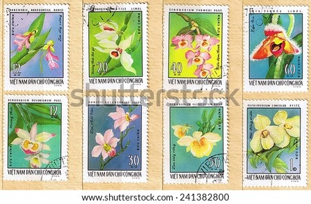 VIETNAM - CIRCA 1976: A set of postage stamps printed in Vietnam shows orchids, series, circa 1976  - stock photo