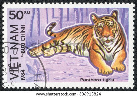 "VIETNAM - CIRCA 1984 : A stamp printed by Vietnam shows a series of images ""Predatory cats"", circa 1984 - stock photo"