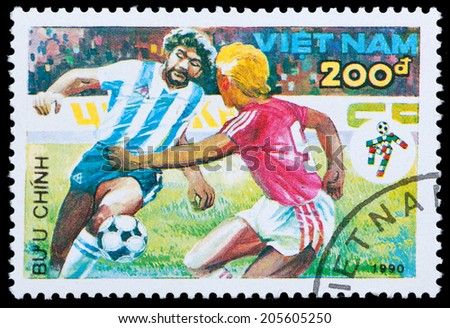 VIETNAM - CIRCA 1990: A stamp printed by Vietnam shows football players. World football cup in Italy, series, circa 1990 - stock photo
