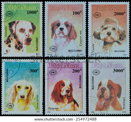 VIETNAM - CIRCA 1990: A stamp printed in Viet Nam, shows dog ,  series Buu Chinh, circa 1990 - stock photo