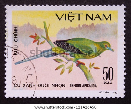VIETNAM - CIRCA 1980: A stamp printed in Vietnam shows a bird on the branch of the tree, circa 1980.
