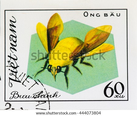 VIETNAM - CIRCA 1982: A stamp printed in Vietnam shows Ong bau Carpenter bees, the genus Xylocopa in the subfamily Xylocopinae, circa 1982 - stock photo