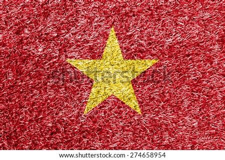 Vietnam flag on grass background texture - stock photo