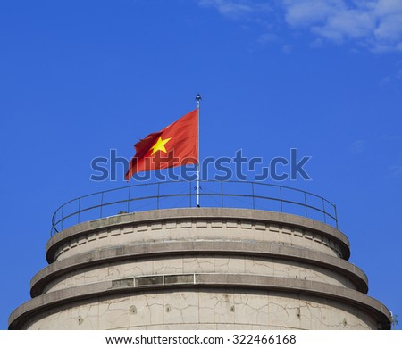 Vietnam flag on tower against blue sky - stock photo