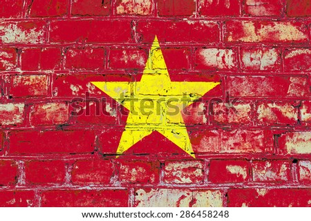 Vietnam flag painted on old brick wall texture background - stock photo