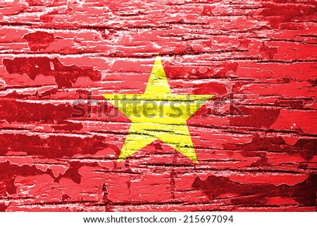 Vietnam Flag painted on old wood background  - stock photo