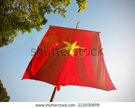 Vietnam flag with lens flare. - stock photo
