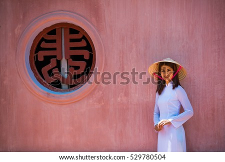 vietnam girl walk in Thien Mu temple hue town