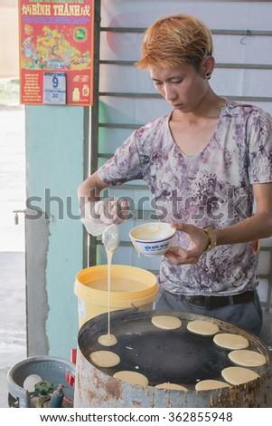 Vietnam 2016 Jan 9 , Unidentified man cooking vietnam pancake on pan in restaurant, Fan tiet city, Vietnam.