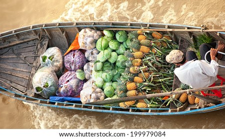 Vietnam, Mekong river delta. Boat on traditional floating market - stock photo