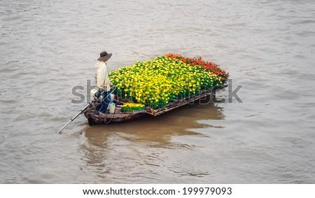 Vietnam, Mekong river delta. Boat on traditional floating market