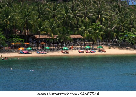 Vietnam Nha Trang secluded palm lined beach on the South China Sea - stock photo