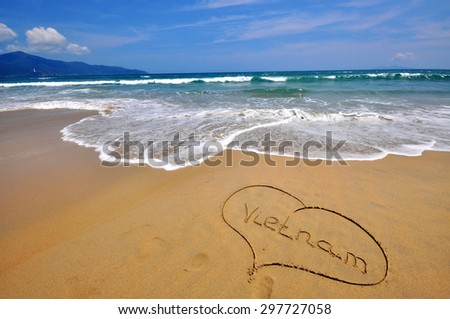 Vietnam sign in the heart shape in the sand beach - stock photo