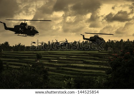 Vietnam War 'style' image circa 1970 helicopters flying over South Vietnamese rice paddies looking for the North Vietnamese Army. (Artist's Impression) - stock photo