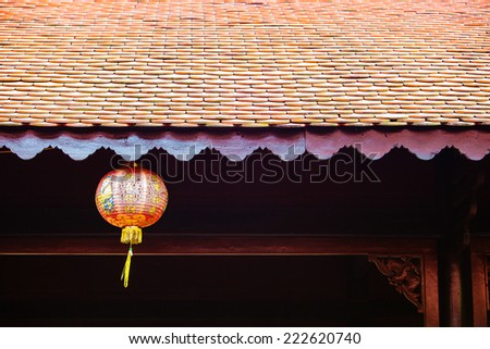 Vietnamese ancient roof and lanterns - stock photo