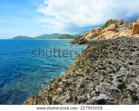 Vietnamese beach, Vietnam ecotourism at Hang Rai, Phan Rang, Ninh thuan, coastal countryside, amazing with large rock, blue water, beautiful place for Vietnam ecotourism