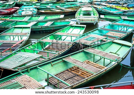 Vietnamese boats on the river early in the morning. Tam Coc, Ninh Binh,. Vietnam travel landscape and destinations - stock photo