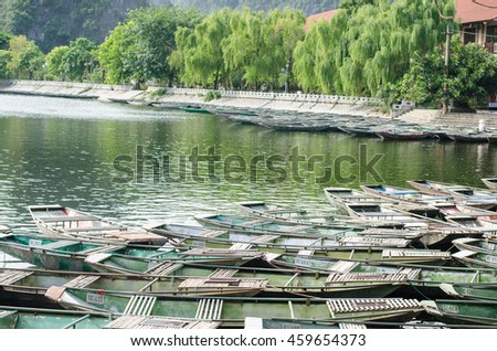 Vietnamese boats on the river early in the morning. Tam Coc, Ninh Binh,. Vietnam travel landscape and destinations